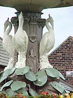 Herons at the top of the fountain